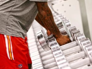 Football Player for the Kansas City Chiefs using Black Iron Strength Thick Handle Dumbbells
